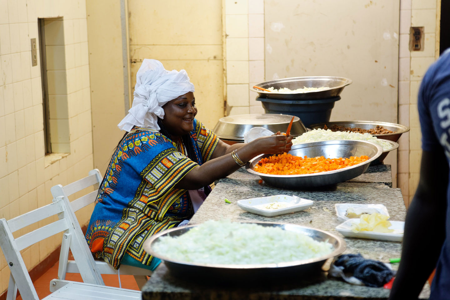 Senegalese woman cooking argentinian food