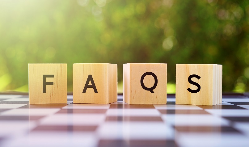 Wooden blocks spelling out FAQS